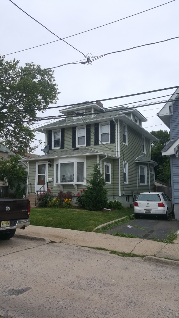 Ridgefield Park, NJ - Completed New vinyl siding project. Alside Conquest Clapboard Juniper Ridge color with white trim and Black shutters.Removed all old aluminum siding. New updated look