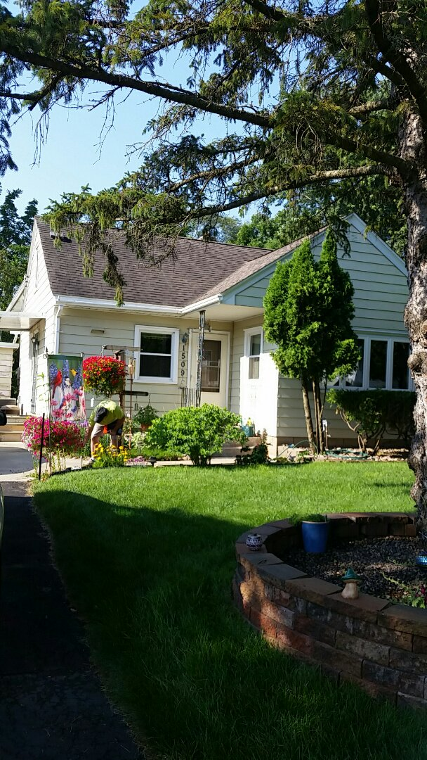Eau Claire, WI - Install ABC steel seamless siding and gutters on new garage
