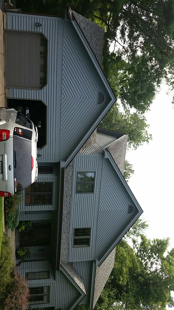 Menomonie, WI - Replacement of tree damaged ABC seamless gutter and Gutter Helmet Leaf Protection system