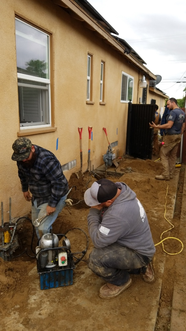Bakersfield, CA - Installing push piers and crawlspace jacks.