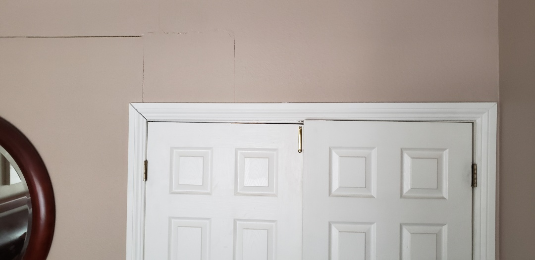 "Mission Viejo, CA - Foundation settlement down almost-2.0"" causing misaligned door."