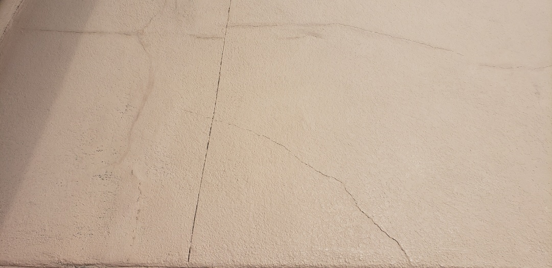 Huntington Beach, CA - Cracked concrete around pool area. Scope would be to grind existing coating mend and repair cracks and apply a new 15 year warranty concrete coating.