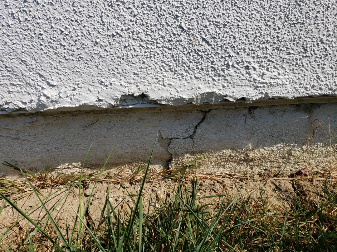"Mission Viejo, CA - Foundation footing crack with -2.4"" of settlement."