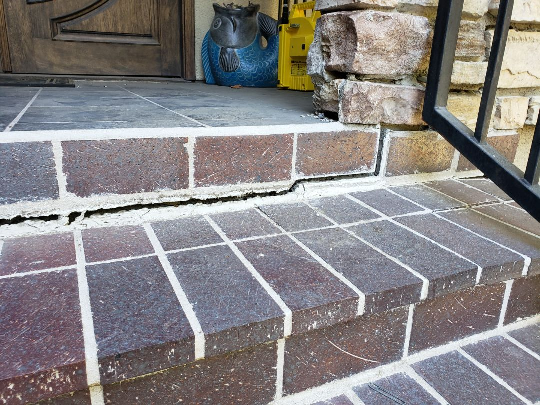 Whittier, CA - Front patio steps settling. Polyurethane injections perfect solution to lift and stabilized.