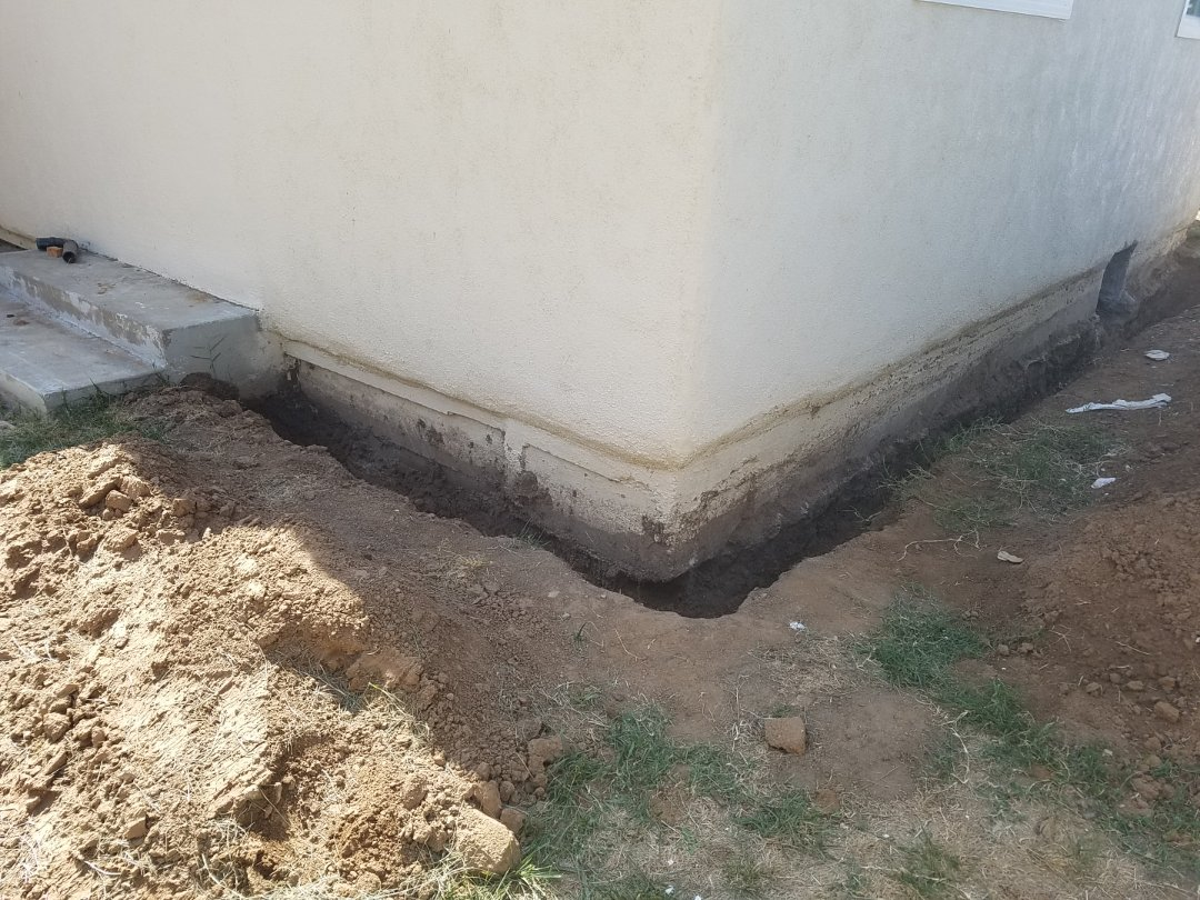 "Foundation footing not installed per building code. Footing was only 10"" below grade. Previous owner competed non permitted work."