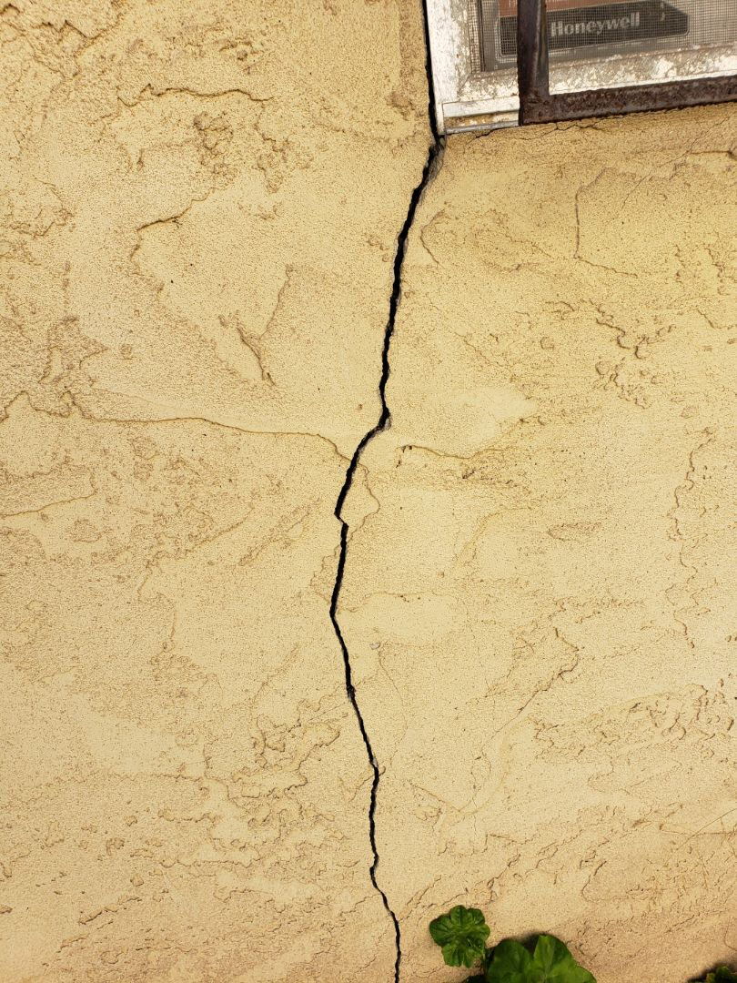 """House settlement by almost-3.0"""" with settlement exterior cracks."""