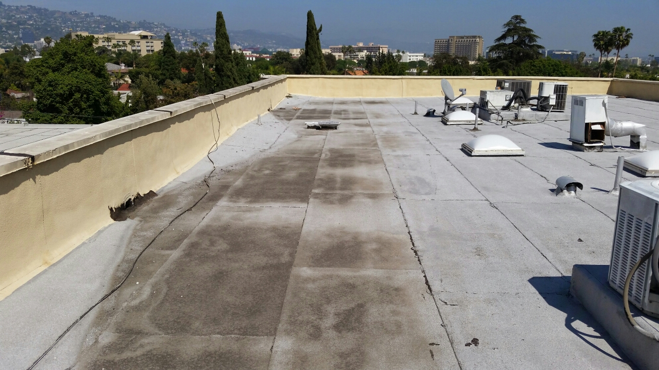 Beverly Hills, CA - Standing water on your roof will make you moldy in side of your home.