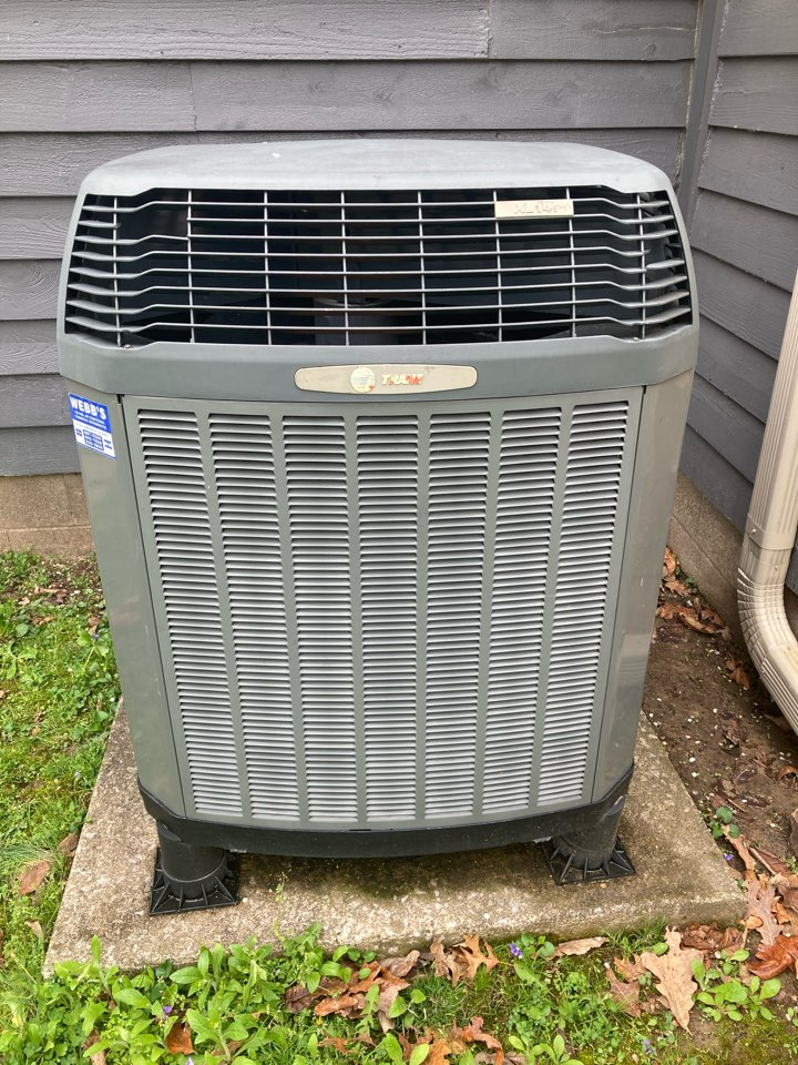 Performing maintenance on a Trane XL 14i heat pump  pump in West Frankfort.