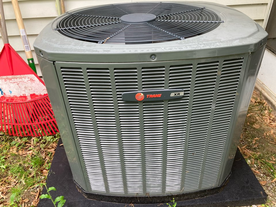 Herrin, IL - Performing maintenance on a Trane XR air conditioner in Herrin.