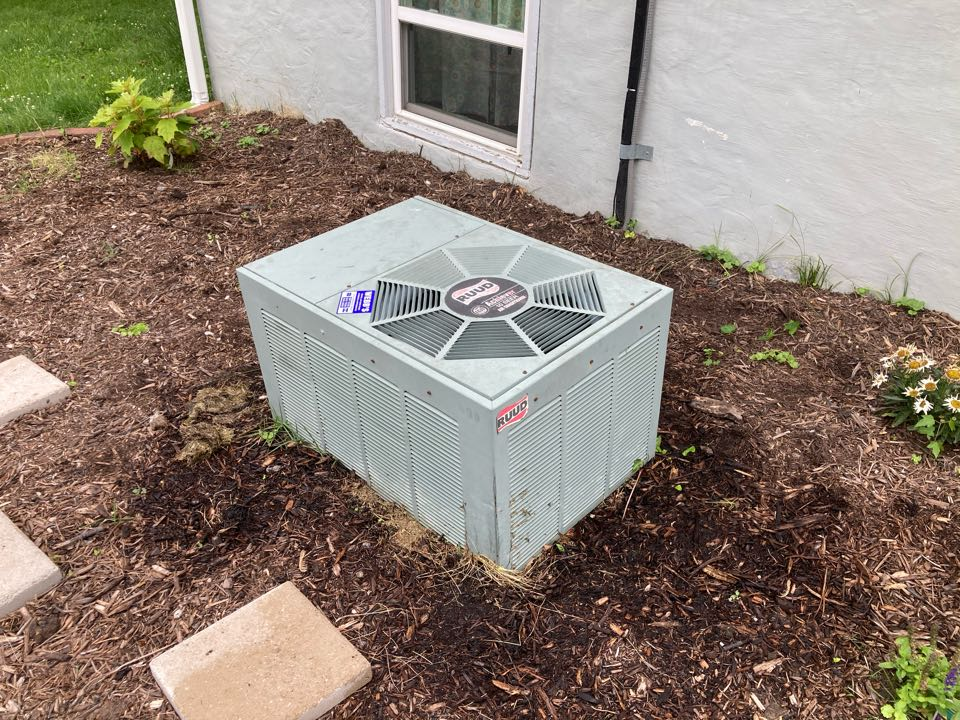 Working on a Ruud air conditioner in West Frankfort.