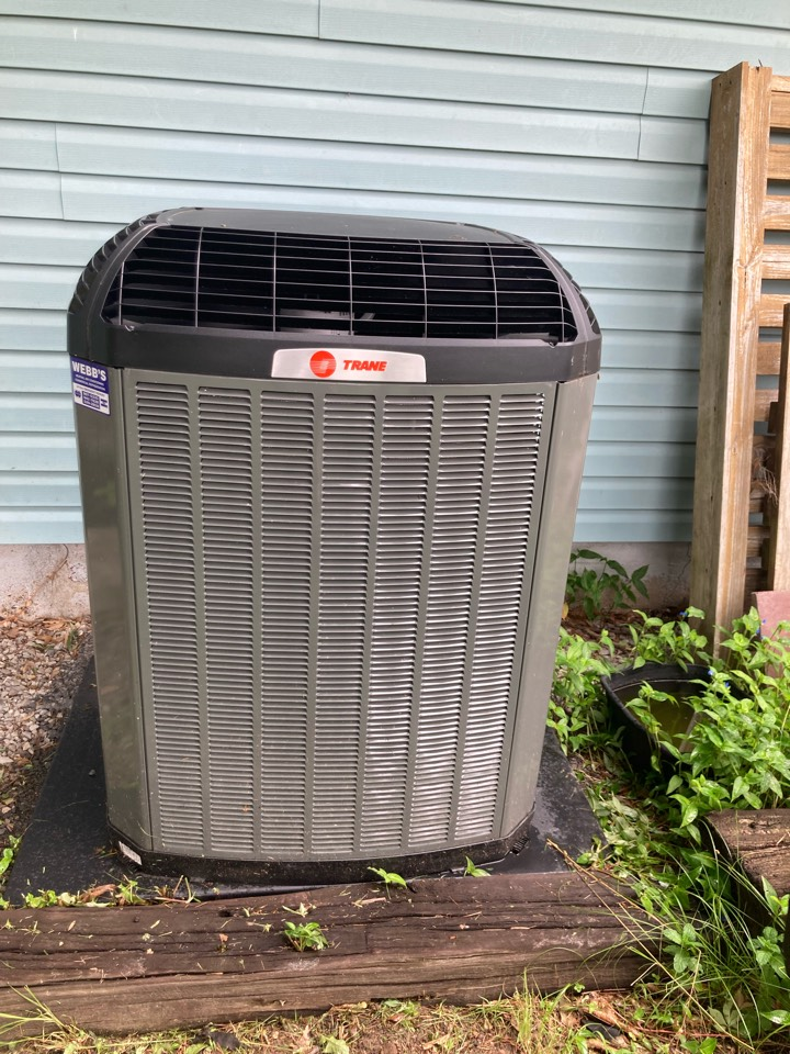 Working on a Trane air conditioner