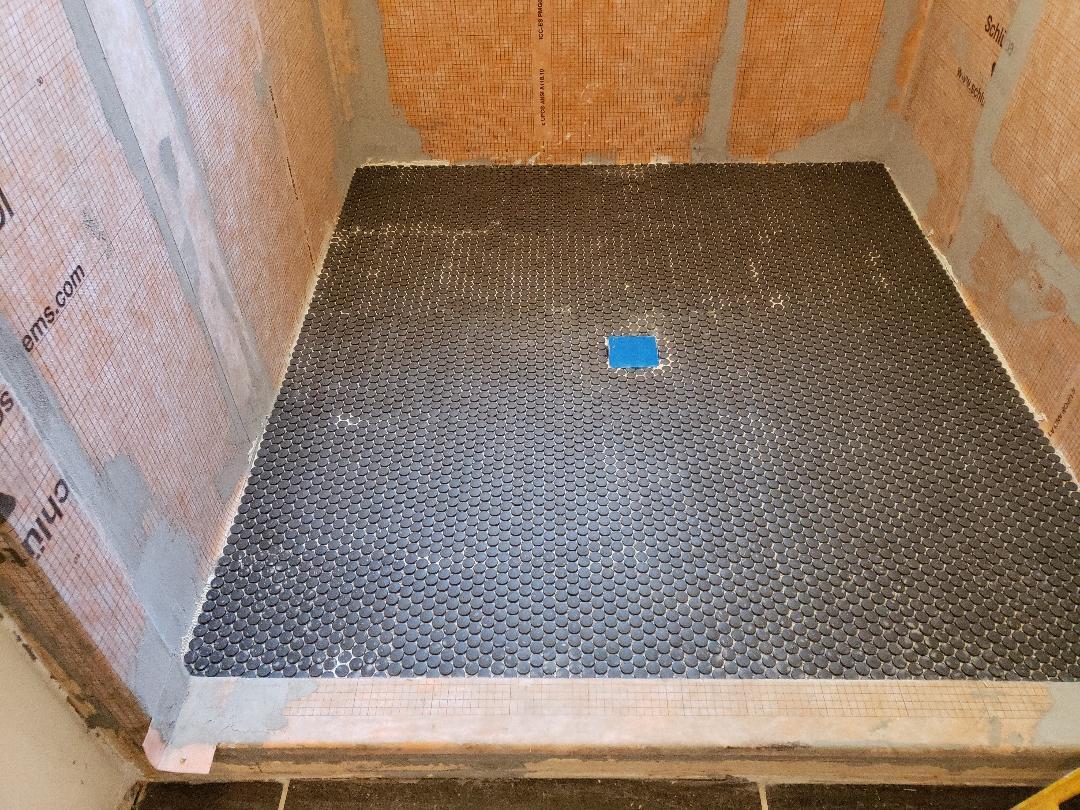 Shower floor tile laid