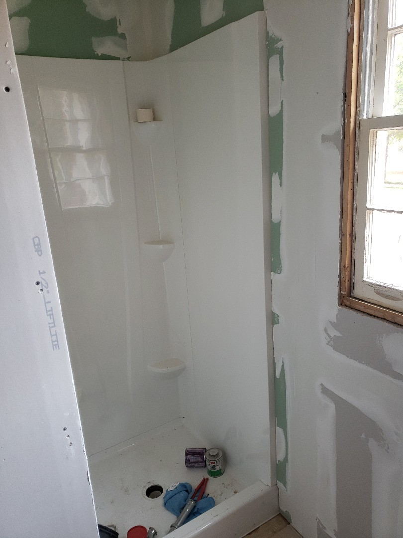 Millbrook, AL - New shower insert and replaced old paneling with sheetrock.