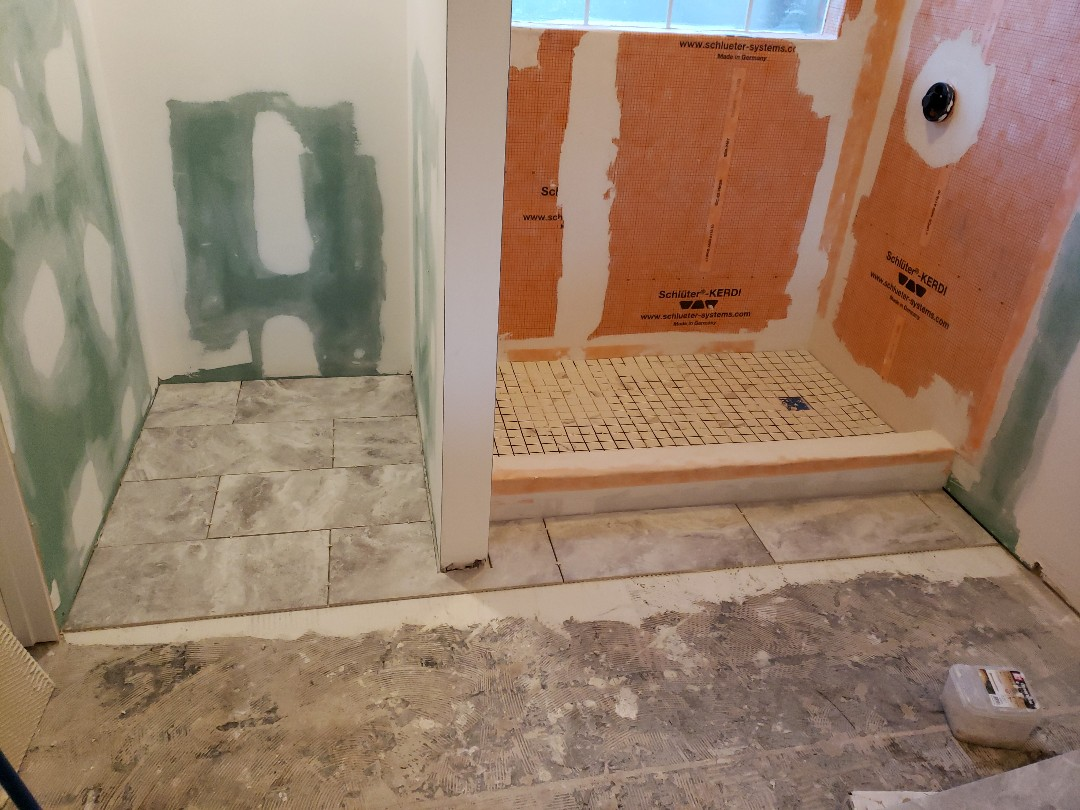 Starting with the tile flooring for shower and floor