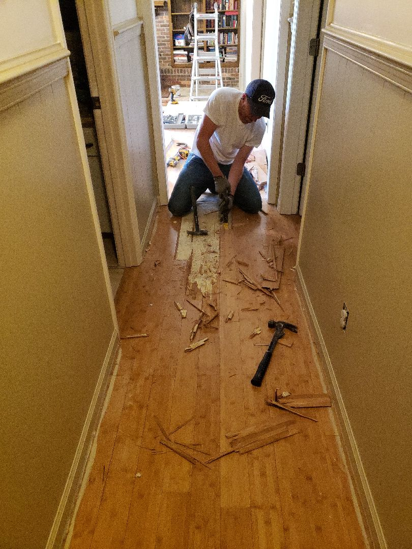 Demoing old floor to install new lifeproof flooring!