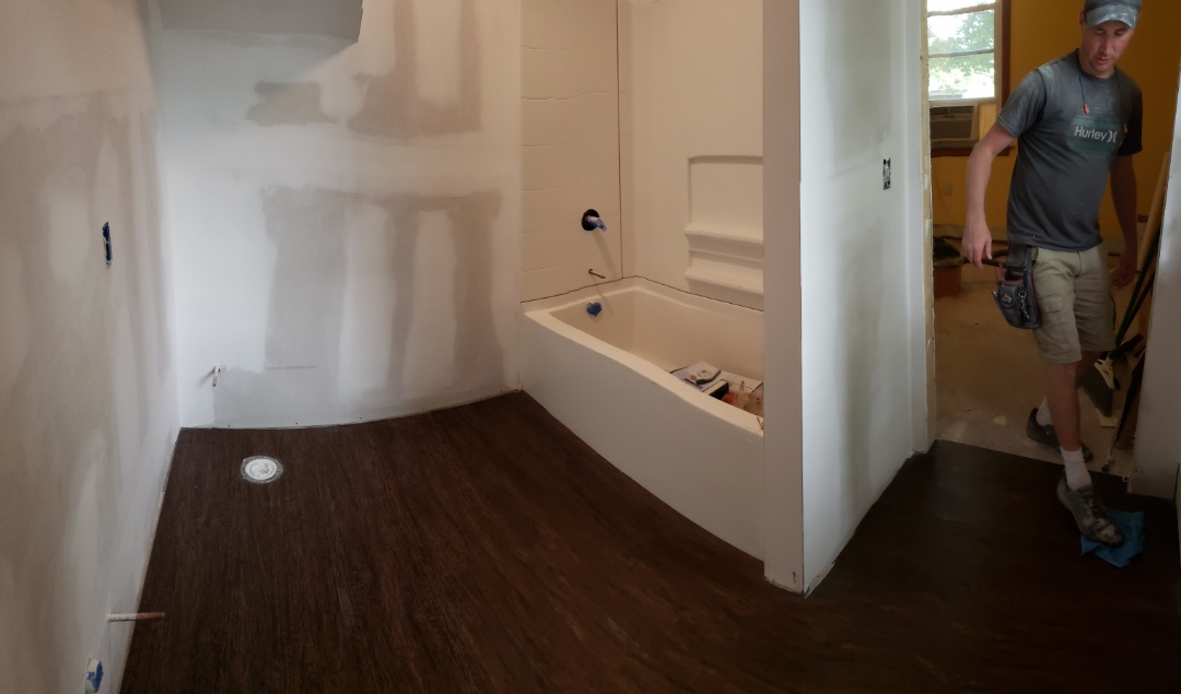 Waterproof flooring down in bathroom addition