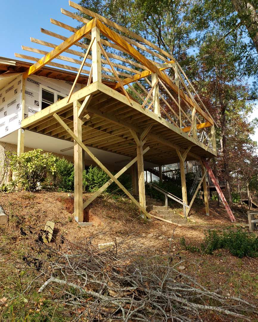 Rafters hung getting ready for striping and metal on porch/deck addition