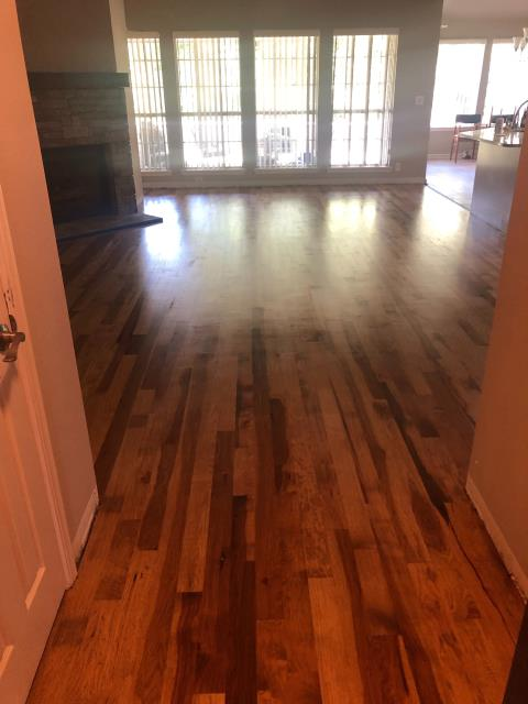 Finished installing new hard wood floors following the demolition and removal of damaged floors after homeowners experienced flooding.