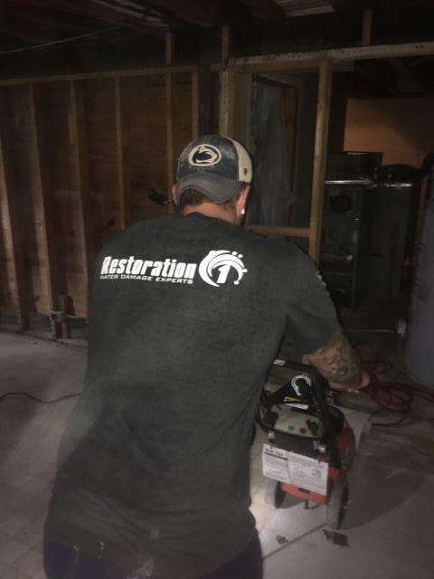 Sanding down floors as part of water mitigation process following a residential water loss!