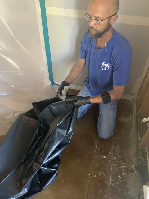Repairing damaged floors after sustaining major water damage.