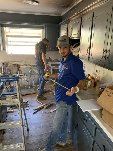 Installation of new cabinetry after old cabinets were removed due to water damage . Resetting counter tops and appliances as well as repairing 'soft floors' as part of the residential water mitigation process.