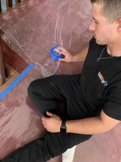 Protecting home owner's carpet as water mitigation services are performed.