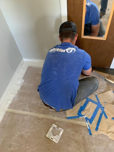 Removing floor paper as water mitigation process continues. The hall bath base tile was replaced with baseboard, the trim piece was installed in the master bath, we also installed a new return cover and a kitchen window sill.