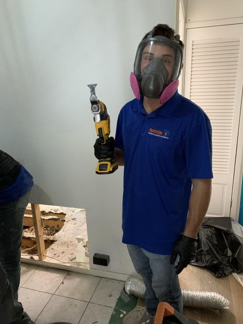 Performing mold abatement services for a residential job.