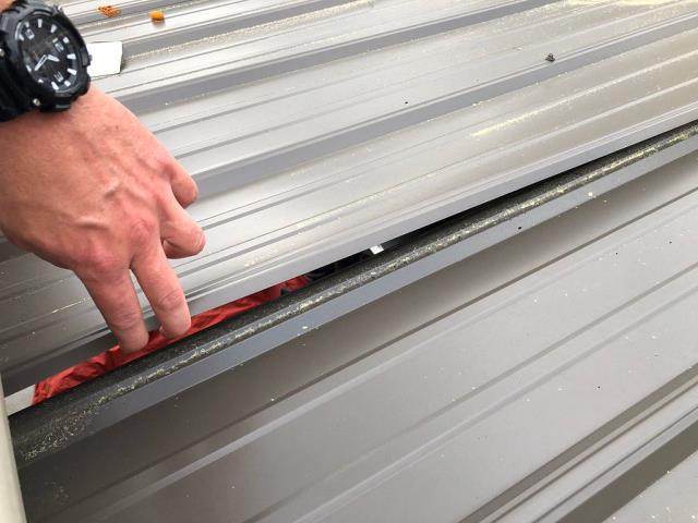 Hoover, AL - Doing a quick metal roof repair