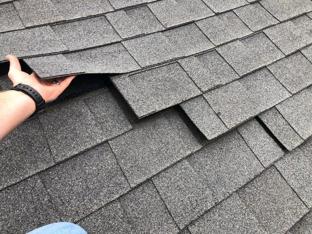Pelham, AL - Shingles loose from wind damage. Was happy to replace roof.