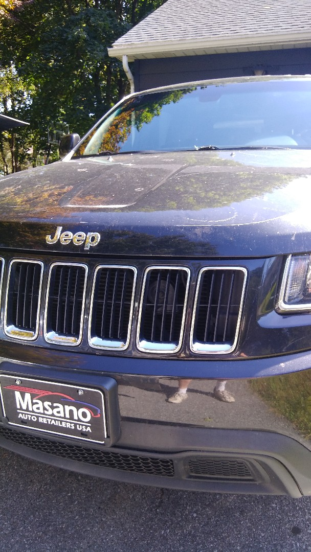Replaced windshield in Jeep Grand Cherokee for a customer at her home