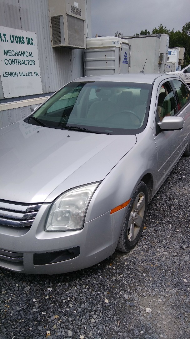 Swiftwater, PA - Replaced windshield for a customer at work on a Ford Fusion