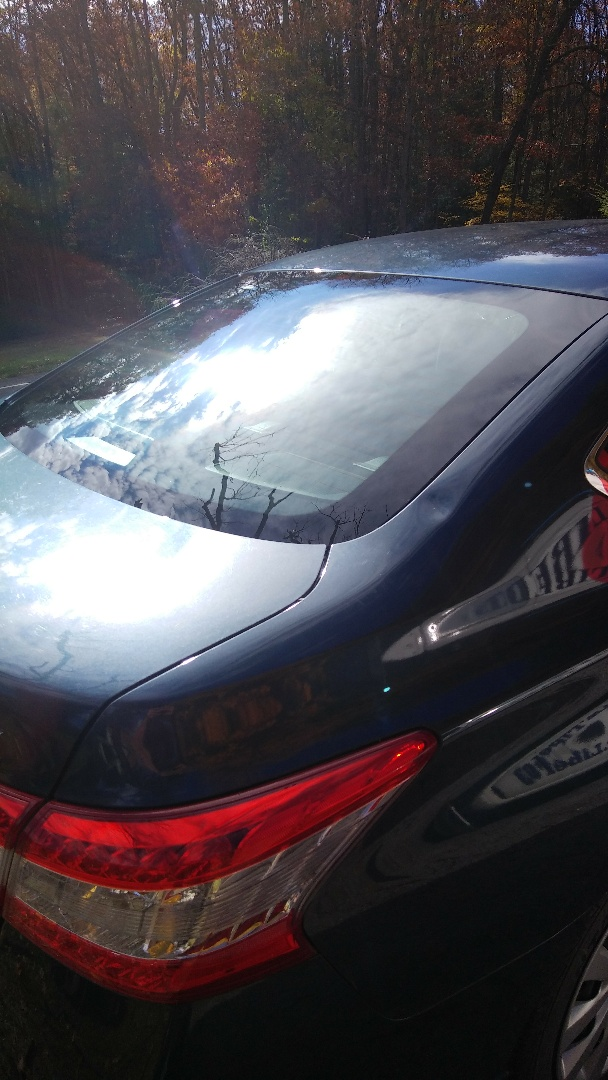 Weatherly, PA - Replaced shattered back window from a fallen tree branch for a customer at her home and processed the insurance claim through Progressive Insurance