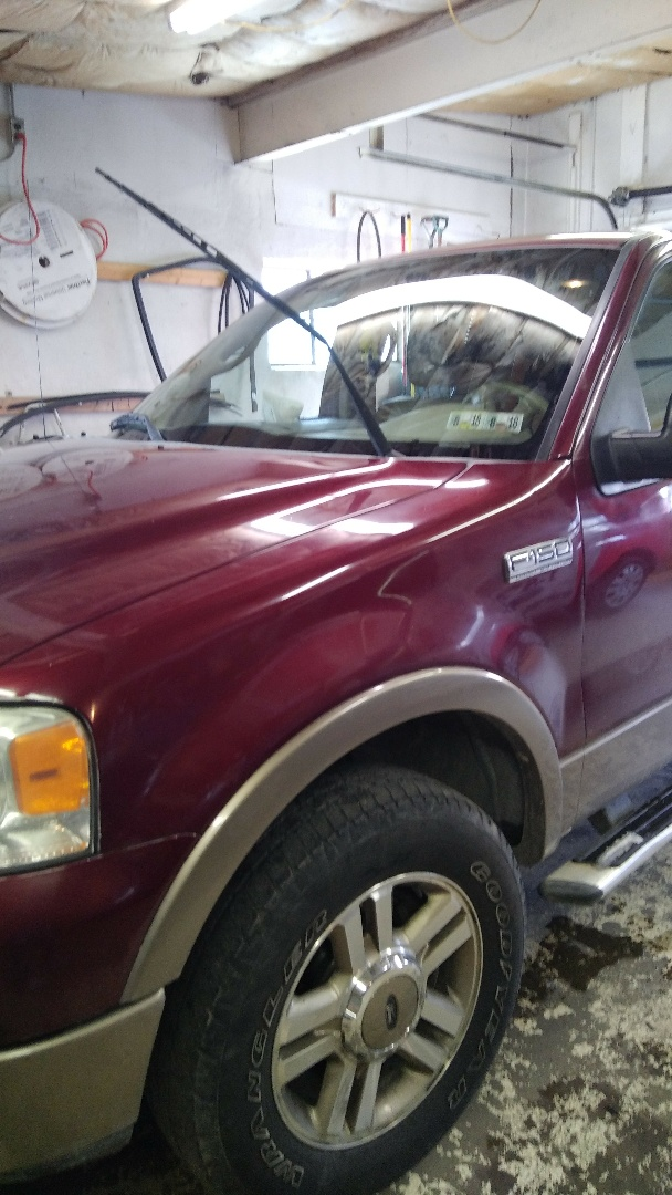 Replaced windshield on Ford F150 for a customer in the shop