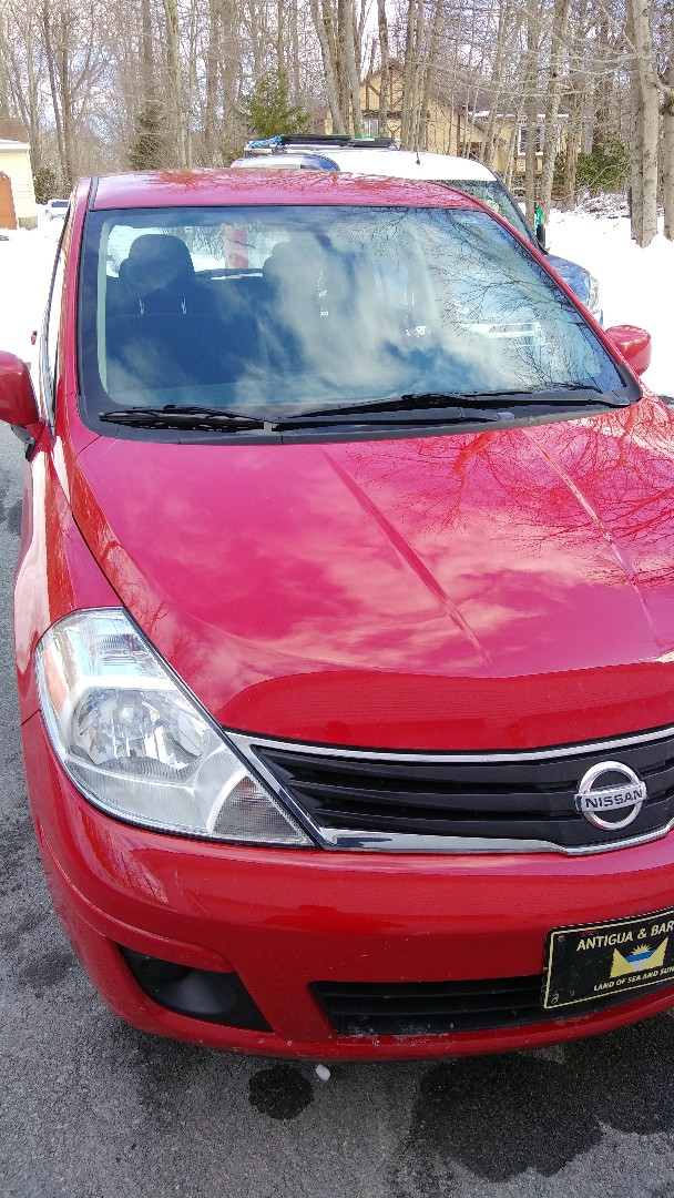 Replaced windshield o Nissan Versa for a customer at her home for the exact price quoted