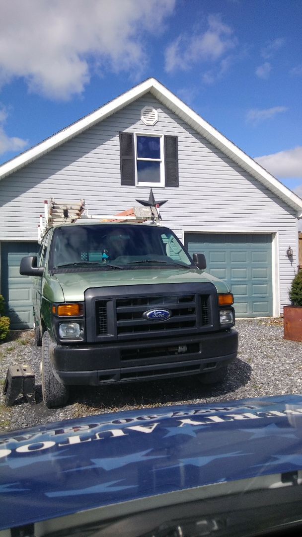 Replaced windshield on Ford Econoline for HT Lyons at their employee's home