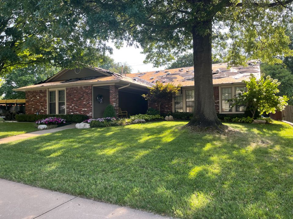 Broken Arrow, OK - Arrowhead Roofing is replacing the roof on this home in Broken Arrow, Oklahoma. If you are in need of a roof replacement or a free roof inspection, contact Arrowhead Roofing today.