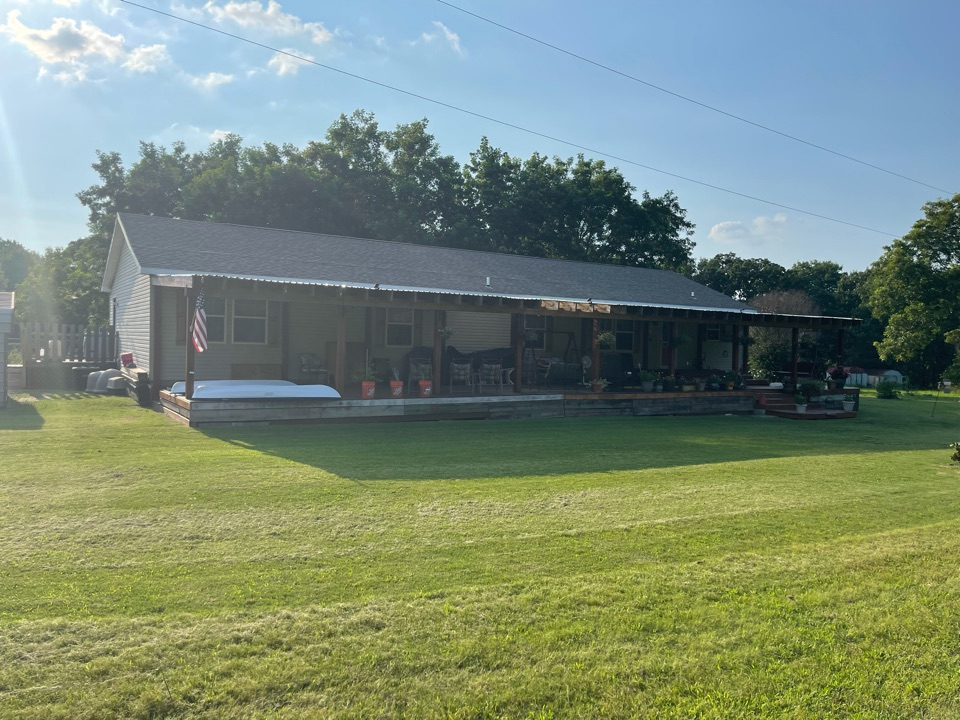Claremore, OK - Arrowhead Roofing is inspecting this roof for hail damage in Foyil, Oklahoma. If you would like a free roof inspection, contact Arrowhead Roofing today.