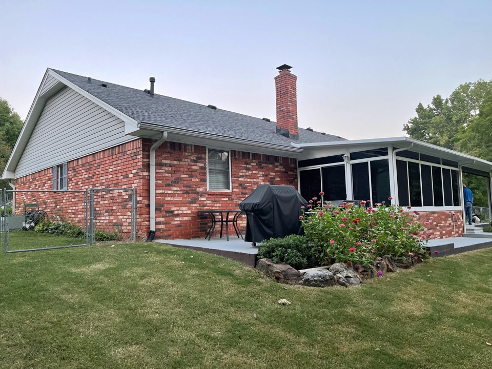 Claremore, OK - Arrowhead Roofing is inspecting the gutters on this sunroom in Claremore, Oklahoma. We will be installing gutter screen to prevent further maintenance for this homeowner.
