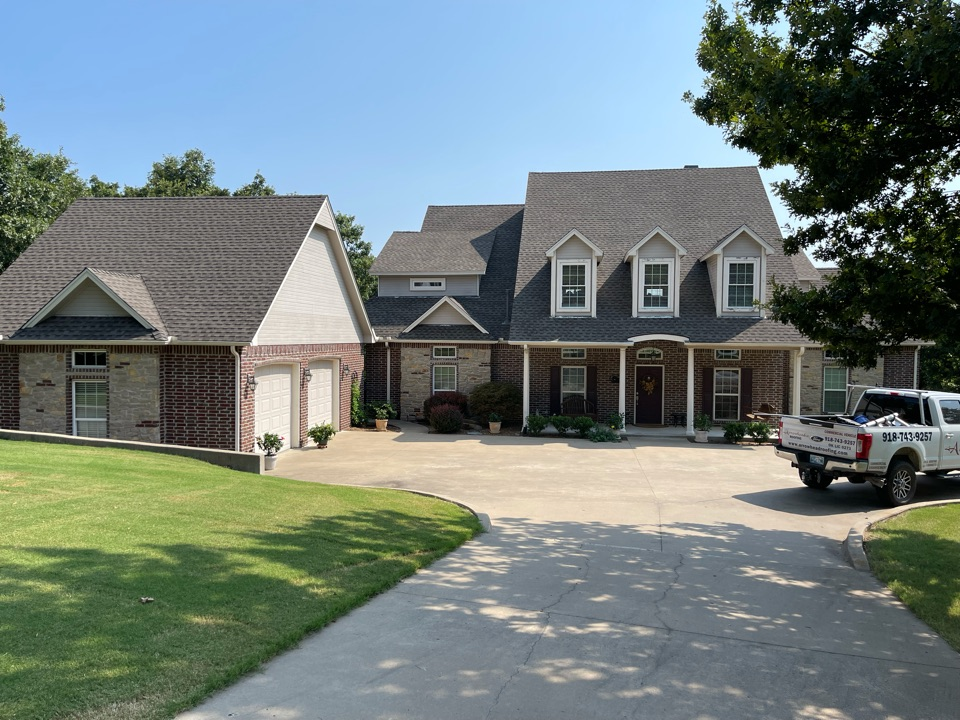 Sand Springs, OK - Arrowhead Roofing installed this GAF Timberline HDZ Weathered Wood roof on this home in Sand Springs, Oklahoma. If you are in need of a roof replacement or would like a free roof estimate, contact Arrowhead Roofing today.