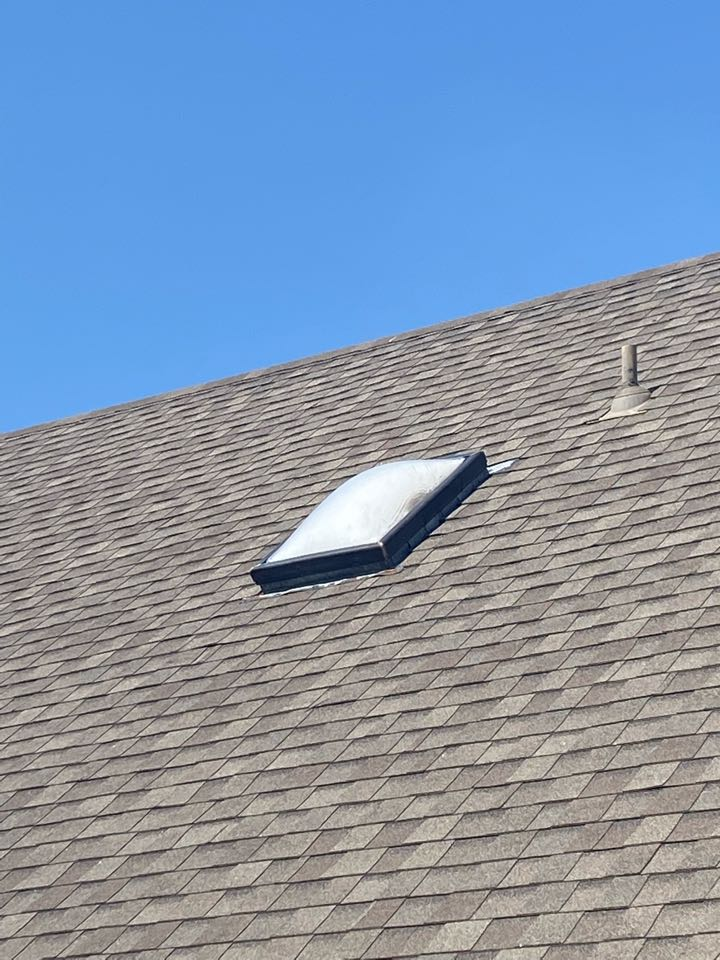 Tulsa, OK - Checking out a leaking chimney chase and leaking skylight on the same house. Quote for New flashing and Skylight replacement.