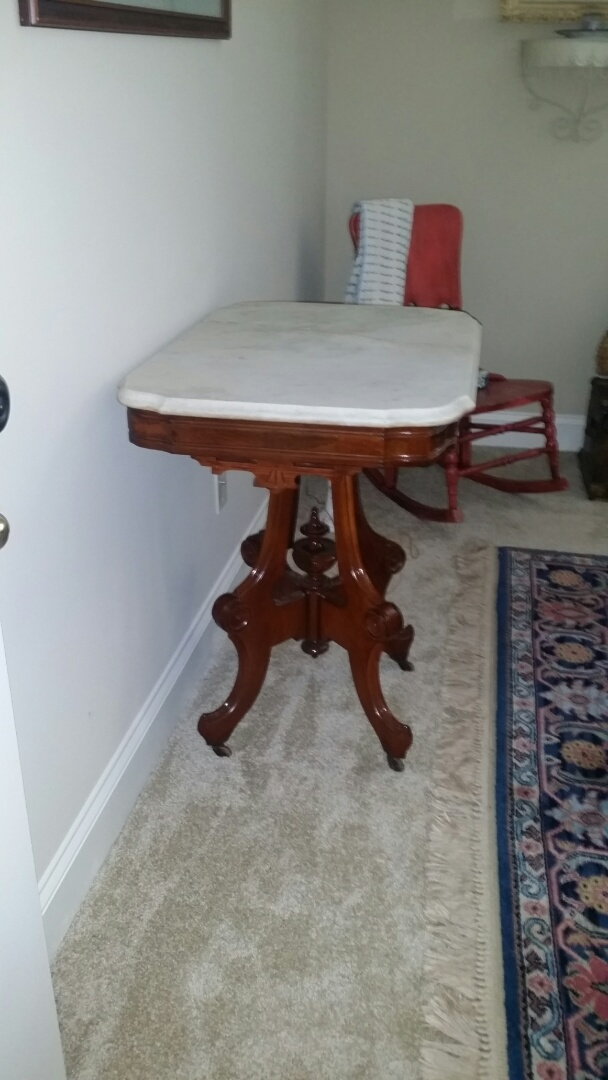 Garner, NC - Furniture repair: Repaired decorative wood trim on marble-top pedestal table.  It looks beautiful!