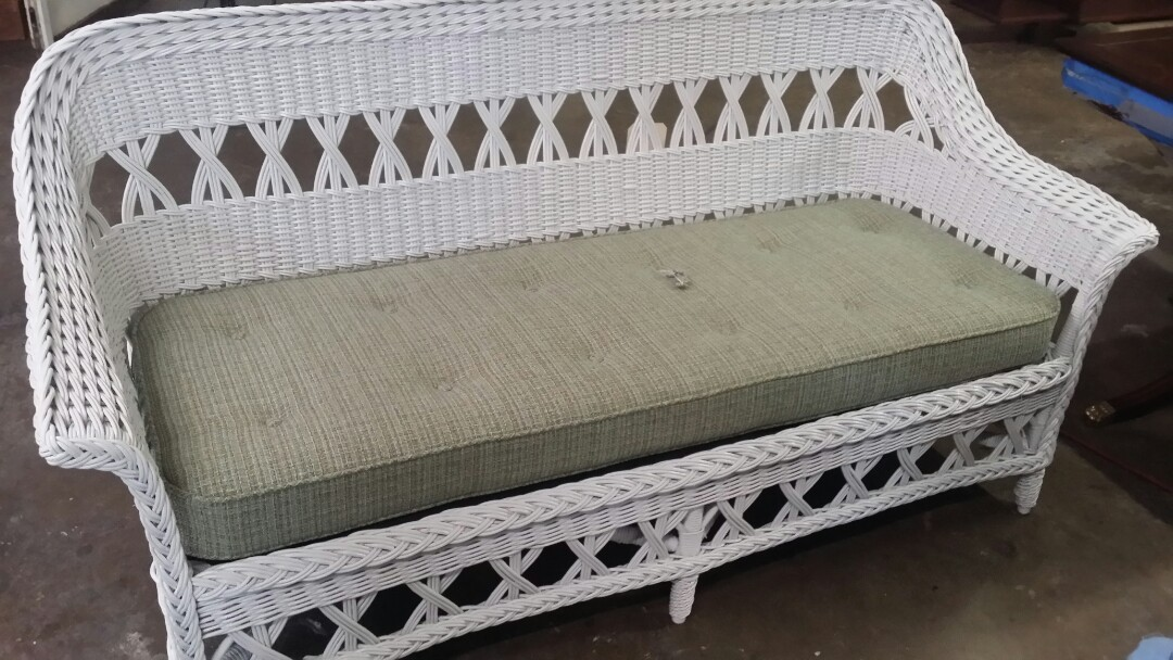 Morrisville, NC - Wicker restoration of this old wicker couch and upholstery of a new cushion.