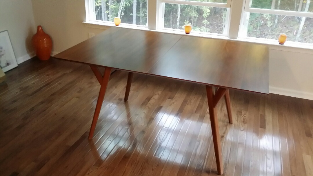 Pittsboro, NC - Repaired and touch up on a dining room table.