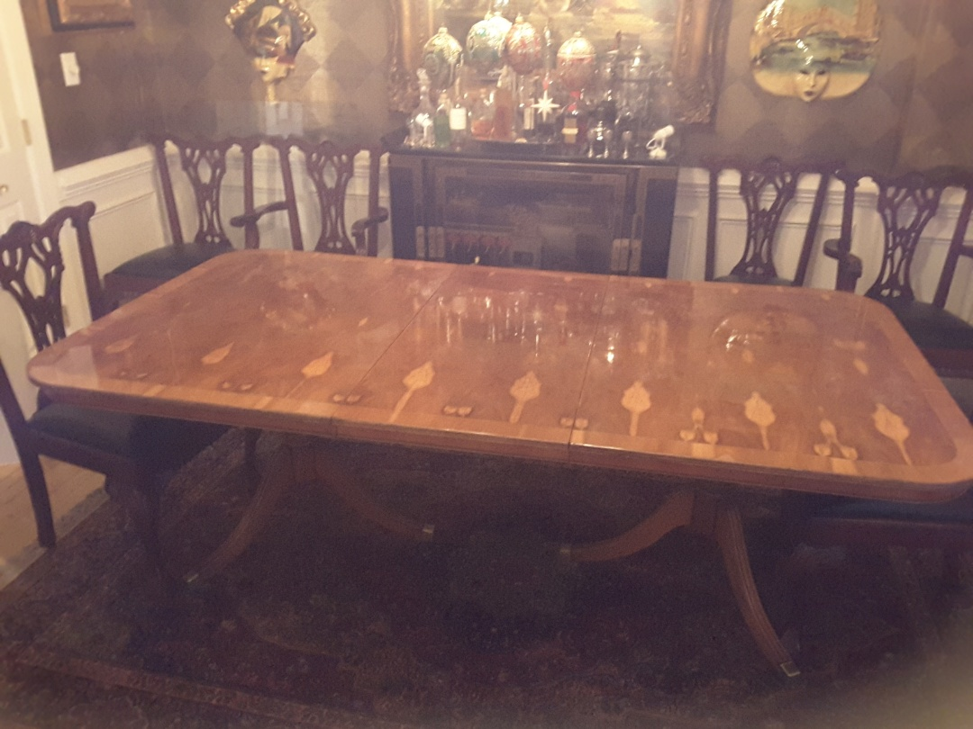 Morrisville, NC - Total Restoration of an antique English ewe wood table, repairing veneer  from water damage, restoration of the finish and buffing to high gloss
