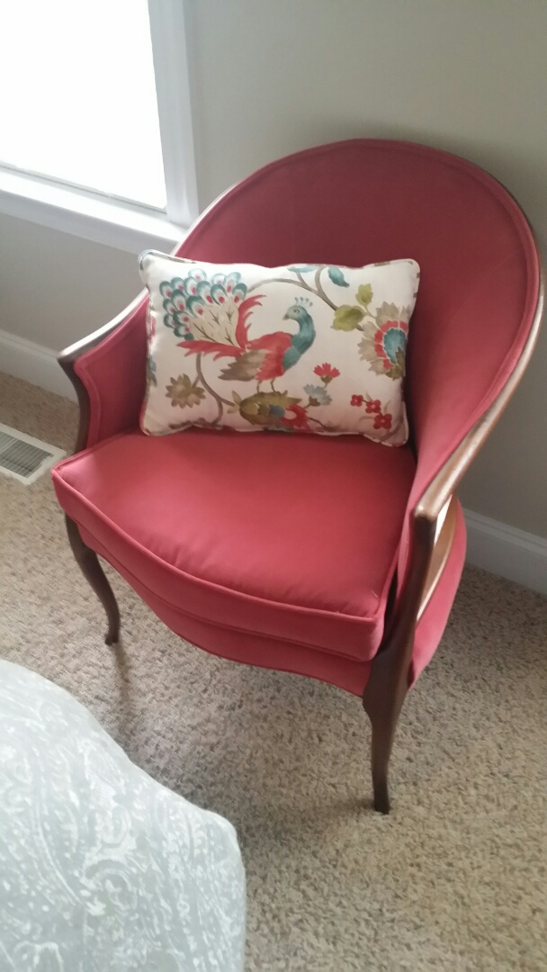 Reupholstered arm chair and throw pillow