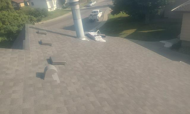 Edmonton, AB - Another GAF Timberline HD roof done by Nomad Roofing! This customer chose Canadian Driftwood as their shingle color!