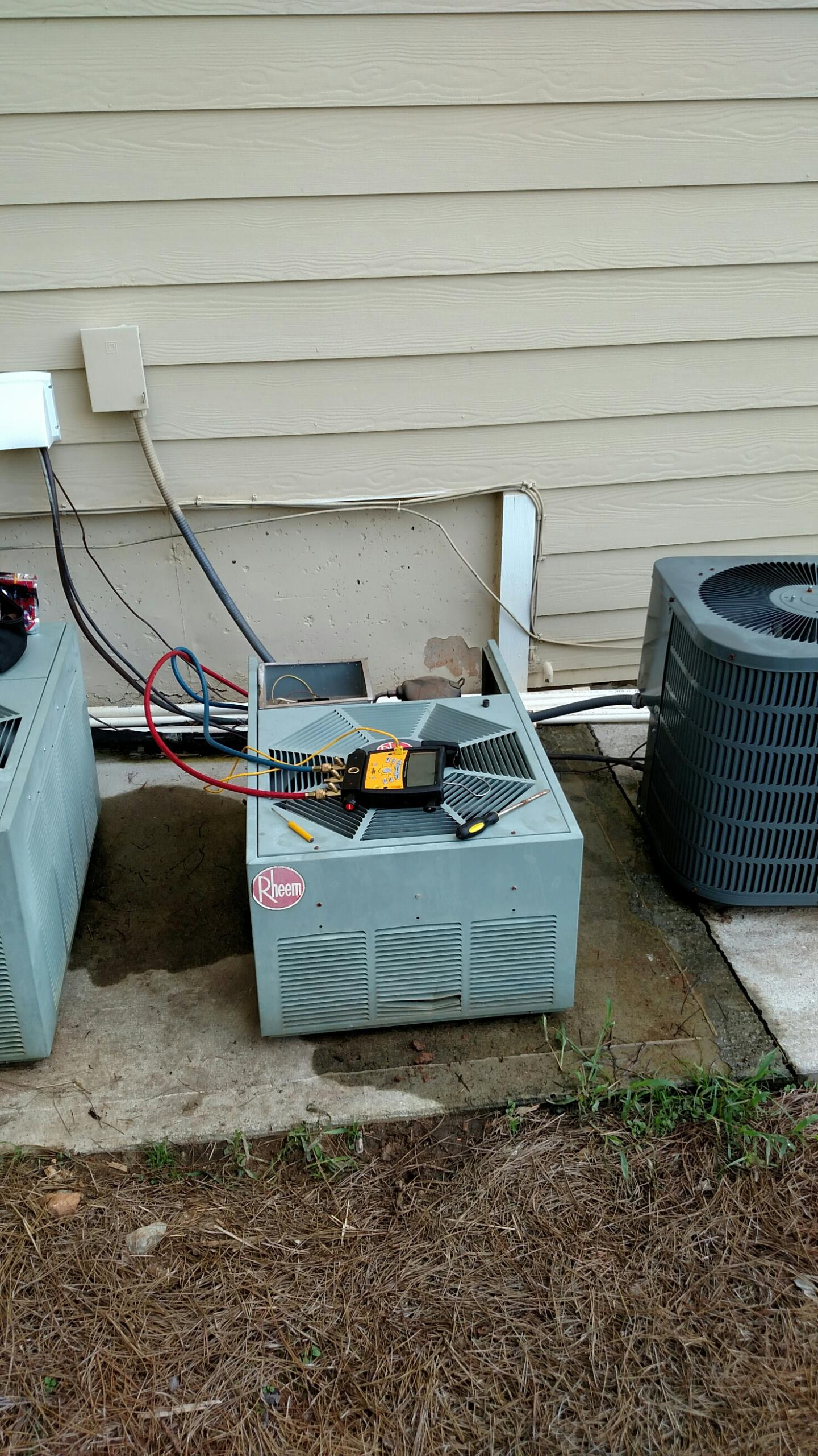 Sugar Hill, GA - Replacing 2 ton Rheem air conditioner with a 16 seer Amana air conditioning system  that has a Lifetime compressor and heat exchanger warranty and 10 years all other parts.