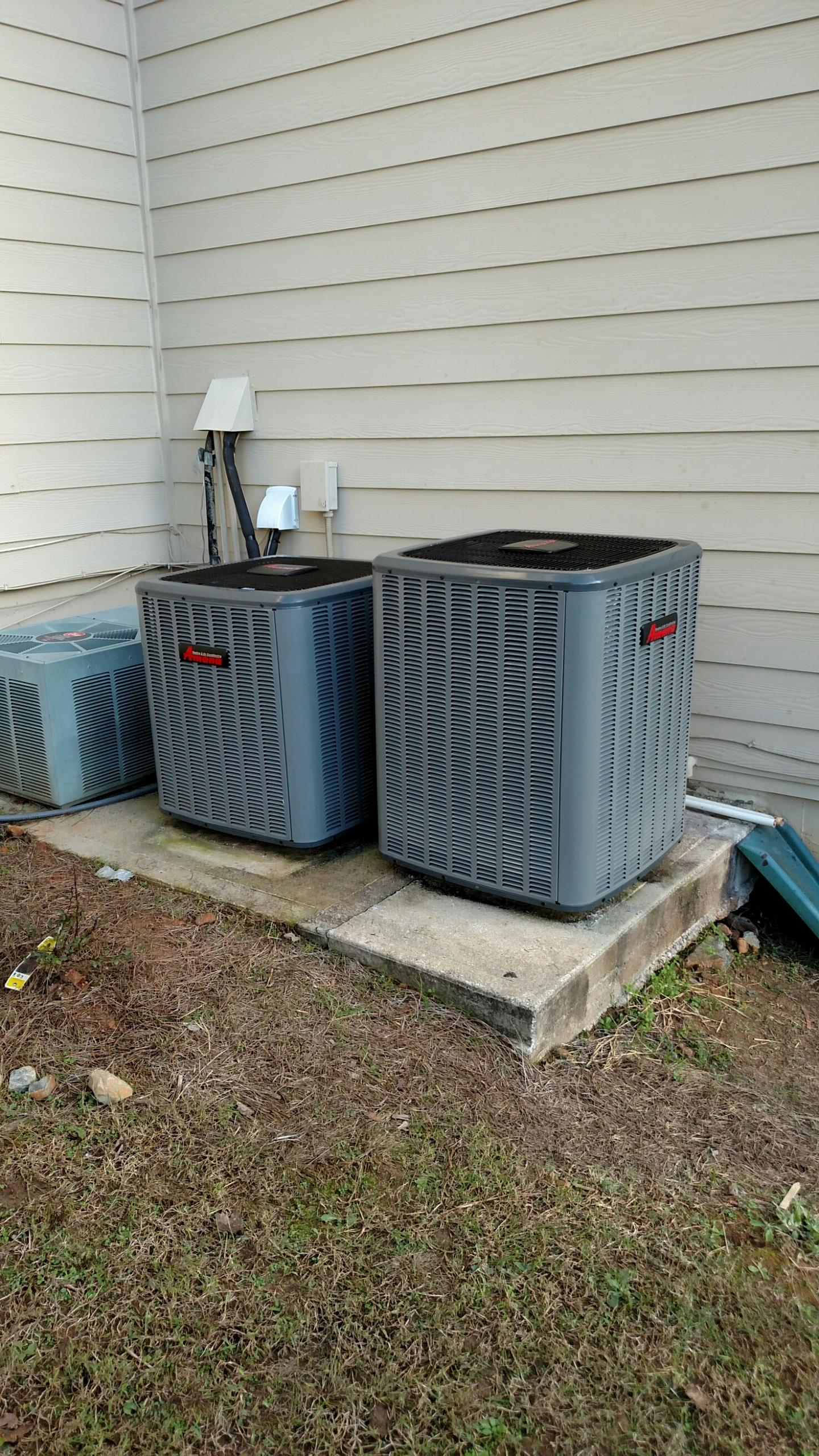 Sugar Hill, GA - Installed the new Amana heat pump all the way to the right. This is the 2nd system that we was able to replace for this customer. Both new systems have Lifetime compressor warranties and 10 years all other parts.