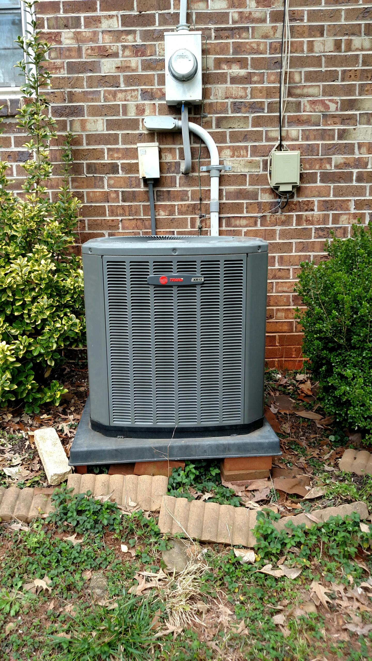 Oakwood, GA - Performing cooling maintenance on this Trane central heating and cooling system that we installed back in 2005.